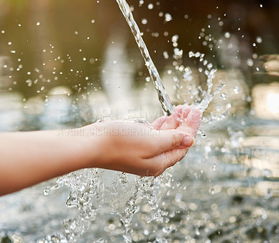 Buy stock photo Cropped shot of hands held out under a stream of water