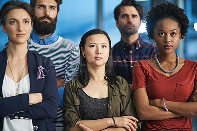 Buy stock photo Cropped shot of a group of creative businesspeople looking determined