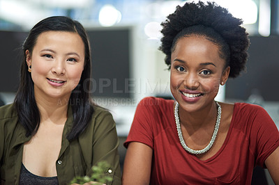 Buy stock photo Cropped portrait of two creative businesswomen in the office