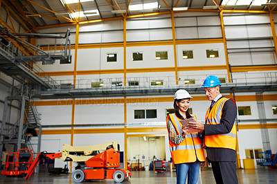 Buy stock photo Shot of two dock workers standing in a dockyard