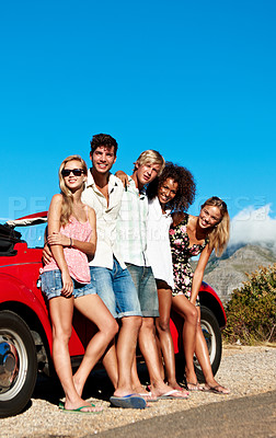 Buy stock photo Portrait of a group of friends on a road trip