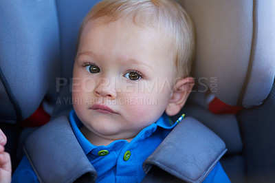 Buy stock photo Portrait of an adorable baby boy sitting in a car seat