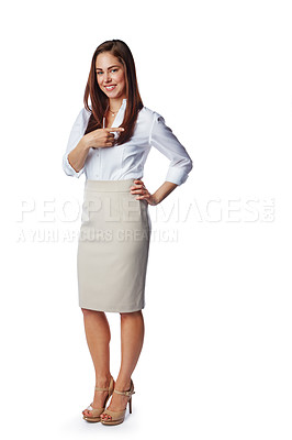 Buy stock photo Studio portrait of a confident young businesswoman pointing towards copy space against a white background