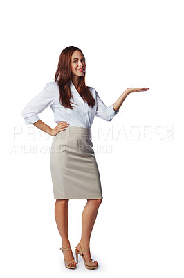 Buy stock photo Studio shot of a confident young businesswoman showing you copyspace against a white background