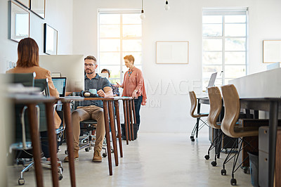Buy stock photo Shot of designers working on computers in a modern office
