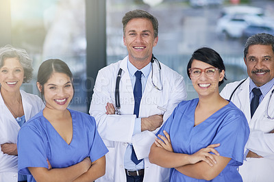 Buy stock photo Portrait of a team of medical practitioners standing together in a hospital