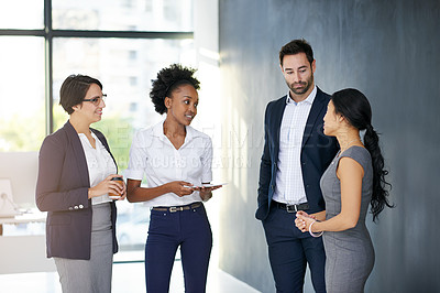 Buy stock photo Cropped shot of a group of businesspeople talking in the office