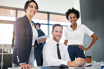 Buy stock photo Cropped portrait of a group of businesspeople gathered around a computer in their office