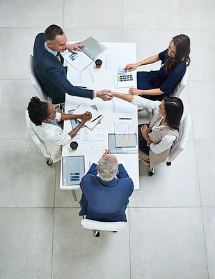 Buy stock photo High angle shot of businesspeople having a meeting in a modern office
