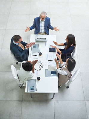 Buy stock photo High angle shot of businesspeople applauding a colleague during a meeting in a modern office