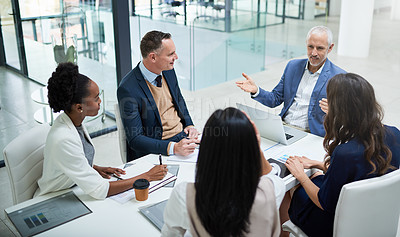 Buy stock photo Cropped shot of businesspeople having a meeting in a modern office