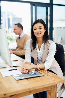 Buy stock photo Cropped portrait of a young businesswoman working alongside a male colleague in the office