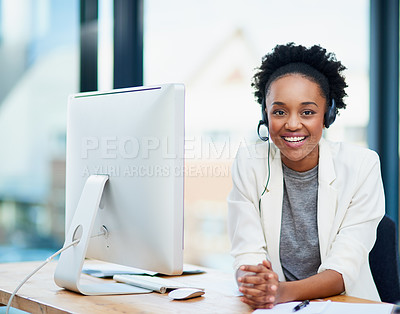 Buy stock photo Cropped portrait of a young businesswoman wearing a headset while sitting in her office
