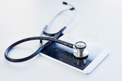Buy stock photo Shot of a stethoscope and digital tablet on a table