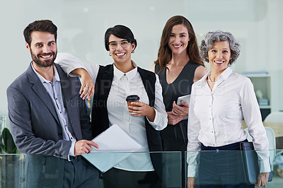 Buy stock photo Portrait of a group of businesspeople standing together in a modern office