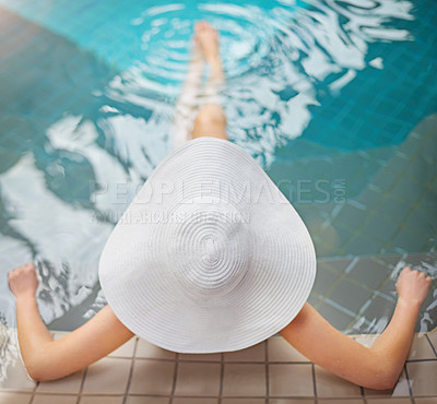 Buy stock photo High angle shot of woman relaxing in the pool at a spa