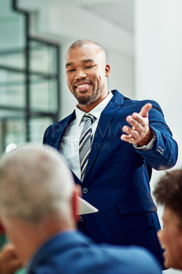 Buy stock photo Cropped shot of a businessman  introducing his colleague during a meeting in the boardroom
