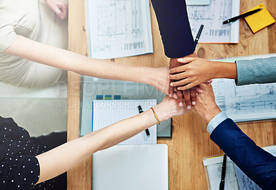 Buy stock photo Cropped shot of a group of unidentifiable businesspeople putting their hands on top of each other during a meeting