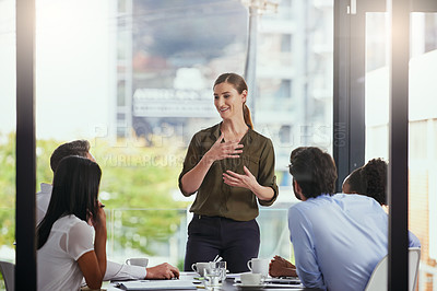 Buy stock photo Cropped shot of a group of diverse businesspeople having a meeting in the boardroom