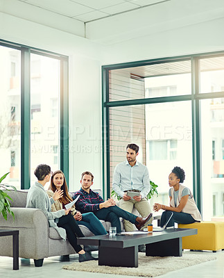 Buy stock photo Shot of a group of colleagues having a discussion in an office