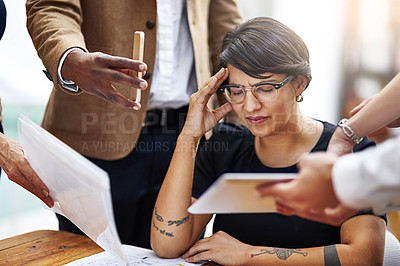 Buy stock photo Cropped shot of a stressed out businesswoman surrounded by colleagues needing help in an office
