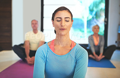 Buy stock photo Cropped shot of a yoga instructor guiding a senior couple in a yoga class