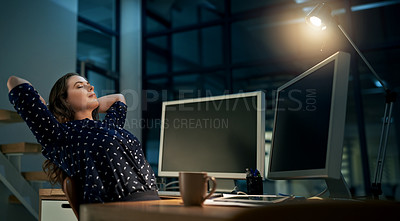 Buy stock photo Cropped shot of a young businesswoman relaxing at her office desk