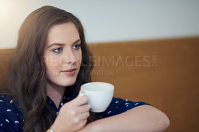 Buy stock photo Cropped shot of a young woman enjoying a cup of coffee