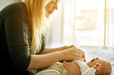 Buy stock photo Shot of a mother spending time with her newborn baby