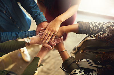Buy stock photo High angle shot of a group of colleagues standing in a circle with their hands in a huddle