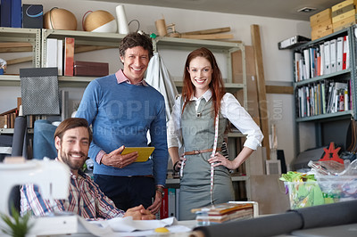 Buy stock photo Portrait of three young fashion designers in their workshop