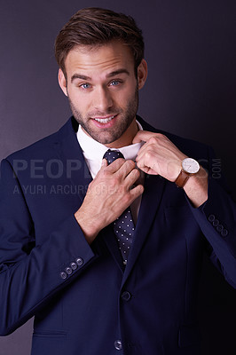 Buy stock photo Cropped portrait of a stylish young businessman posing in the studio