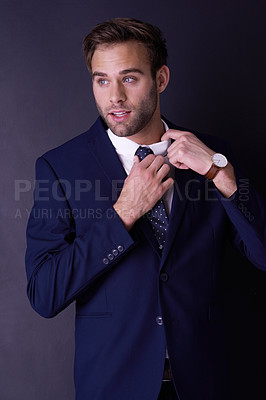 Buy stock photo Cropped shot of a stylish young businessman posing in the studio