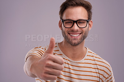 Buy stock photo Studio portrait of a young man giving you a thumbs up