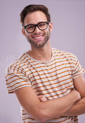 Buy stock photo Studio portrait of a confident young man posing against a lilac background
