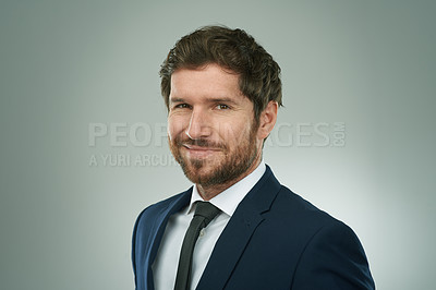 Buy stock photo Studio portrait of a corporate businessman posing against a grey background