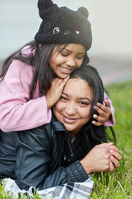 Buy stock photo Cropped shot of a little girl playing with her mother's hair outside
