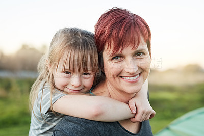 Buy stock photo Cropped portrait of a little girl and her mother standing outside