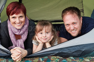 Buy stock photo Portrait of a cute little girl and her parents sitting inside a tent together