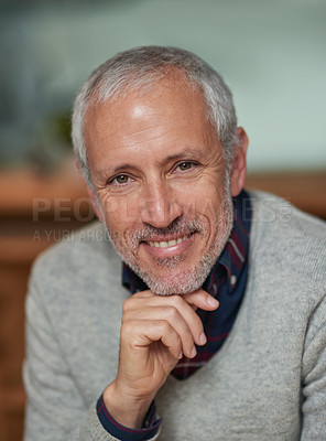 Buy stock photo Portrait of a smiling mature businessman sitting in an office