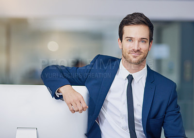 Buy stock photo Portrait of a young businessman leaning on his pc in the office