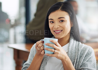Buy stock photo Portrait of a young businesswoman enjoying a cup of coffee