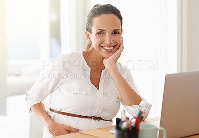 Buy stock photo Portrait of a young pregnant woman working on a laptop at home