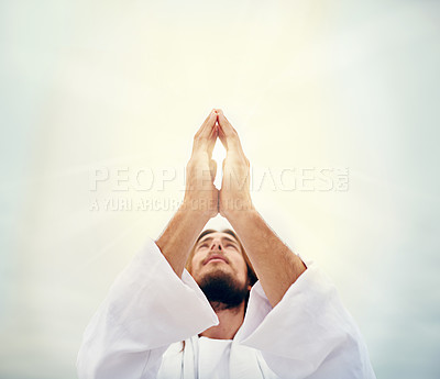 Buy stock photo Shot of Jesus praying while standing on a bare landscape