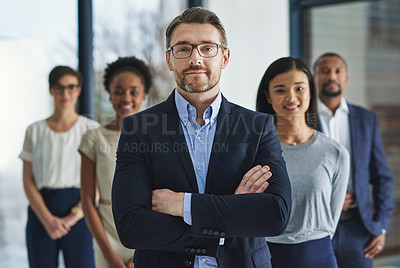Buy stock photo Cropped shot of a group of businesspeople standing in the office