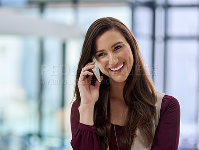 Buy stock photo Shot of a businesswoman talking on her cellphone at the office