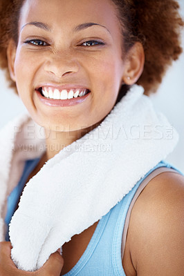 Buy stock photo Closeup portrait of a happy young African American woman smiling with a towel around her neck
