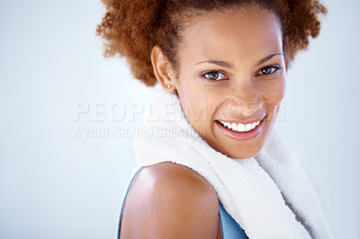 Buy stock photo Portrait of a pretty young fitness woman smiling against grey background