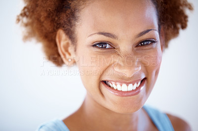 Buy stock photo Closeup portrait of a smiling young female looking againsdt grey background