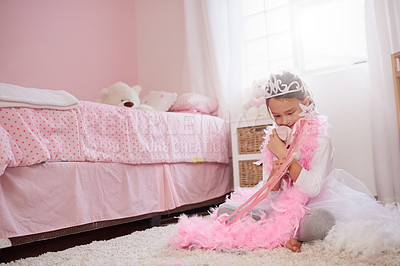 Buy stock photo Shot of a little girl dressed up as a princess while playing make believe